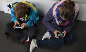 Keeping track of kids online: 39% of parents read their child's email